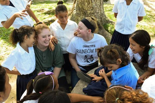 DeSales University students talking and playing with students at a local school in Honduras. [FEED THE CHILDREN]