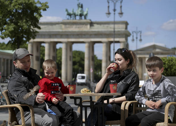 Europe relaxing virus restrictions but cases flare elsewhere