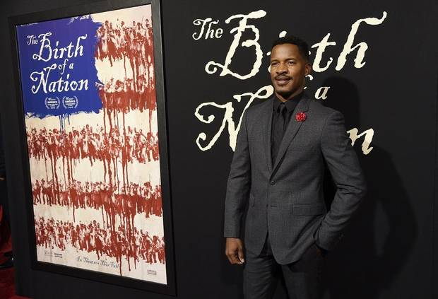 "This Sept. 21, 2016, file photo shows Nate Parker, the director, screenwriter and star of ""The Birth of a Nation"" at the premiere of the film in Los Angeles. Parker premiered his new film ""American Skin"" at the Venice Film Festival. It's his first film since a past rape allegation derailed the release of his Nat Turner biopic ""The Birth of a Nation."" [Photo by Chris Pizzello/Invision/AP, File]"