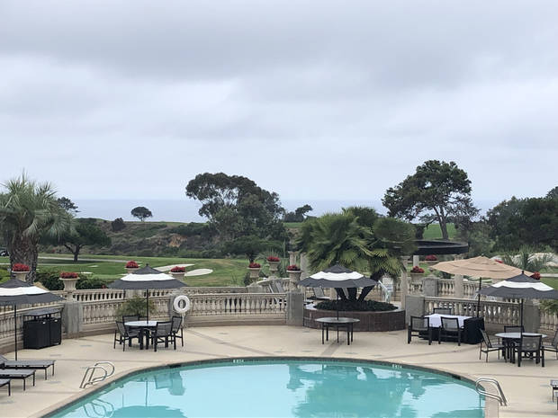 Torrey Pines Golf Club sits just beyond the pool at the Hilton Torrey Pines resort in the San Diego suburb of La Jolla. (Photo by Berry Tramel)