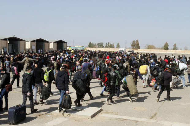 From Iran's hot zone, Afghans flee home, spreading virus