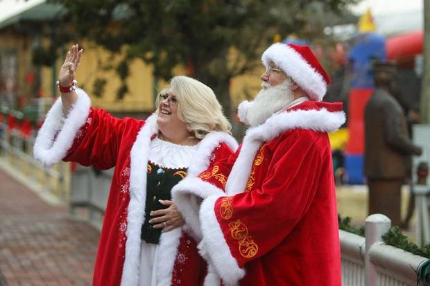 "Ron Herendeen, known as Santa Ron, and his wife, Elaine Herendeen, known as Mrs. Claus, make an appearance at the Oklahoma Railway Museum in their ""dress reds."" Photo provided"