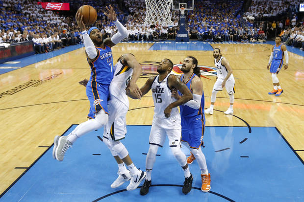 Oklahoma City's Carmelo Anthony (7) goes to the basket beside Utah's Rudy Gobert (27) and Derrick Favors (15) as Steven Adams (12) watches during Game 5 of the first round NBA playoff series between the Oklahoma City Thunder and the Utah Jazz at Chesapeake Energy Arena in Oklahoma City, Wednesday, April 25, 2018. Utah won 102-95. Photo by Bryan Terry, The Oklahoman