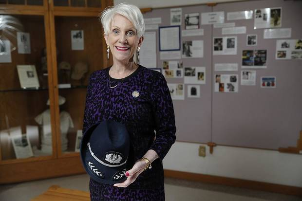 Beverley Bass poses with the hat from her American Airlines uniform at the 99s Museum of Women Pilots in Oklahoma City,Tuesday, Jan. 21, 2020. [Sarah Phipps/The Oklahoman]