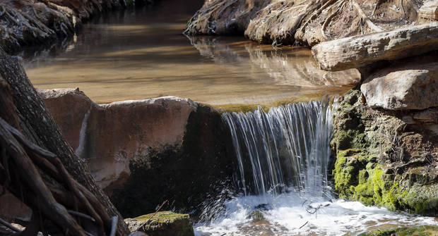 Water flows from a spring along the Spring Loop Trail at Roman Nose State Park, north of Watonga, Okla., on Monday, March 25, 2019. [The Oklahoman Archives]