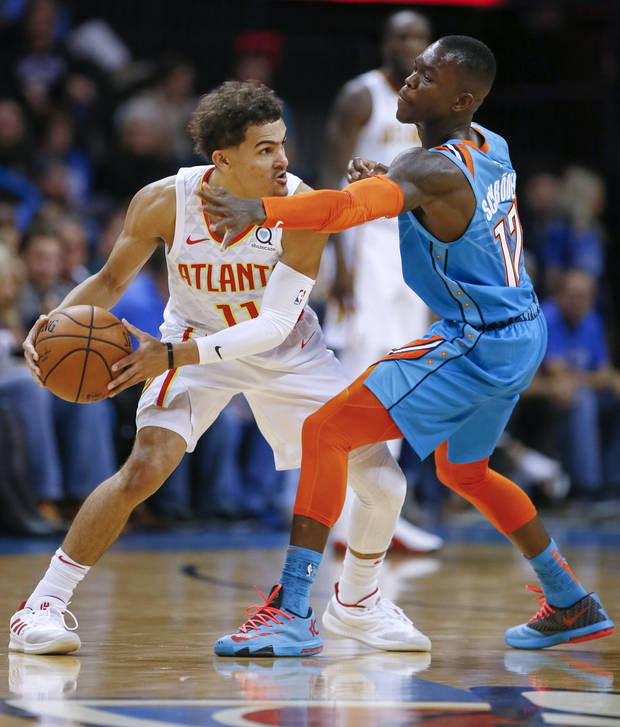 0780a137630e Oklahoma City s Dennis Schroder (17) defends Atlanta s Trae Young (11)  during an