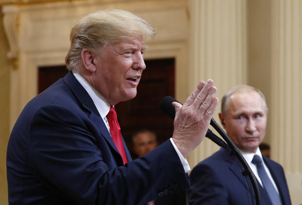U.S. President Donald Trump speaks with Russian President Vladimir Putin during a press conference after their meeting Monday at the Presidential Palace in Helsinki, Finland. (AP Photo/Pablo Martinez Monsivais)