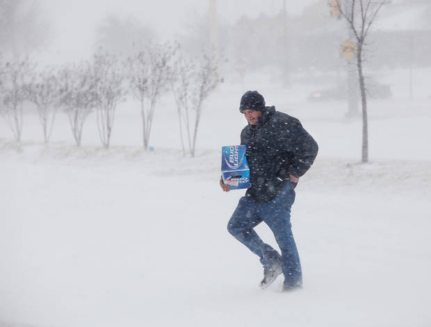 blizzard conditions in Oklahoma City Thursday, Dec. 24, 2009. A man carries beer from a convenience store to his motel room near Reno and Meridian. Photo by Jim Beckel, The Oklahoman ORG XMIT: KOD