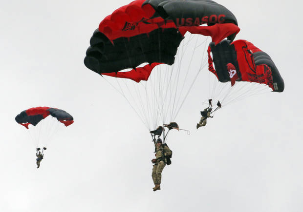 The U.S. Army Special Operations Command Parachute Demonstration Team, the Army Black Daggers, parachutes into the stadium before Saturday's game. [PHOTO BY STEVE SISNEY, The Oklahoman]