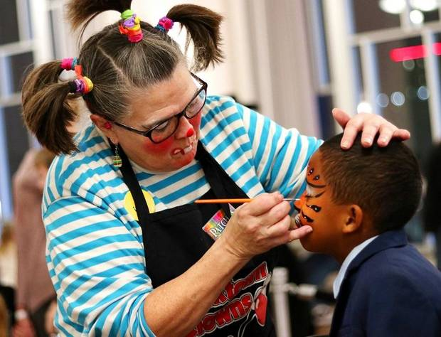 Patches, one of the Bricktown Clowns, paints the face of CJ David, 8, at Opening Night 2019 in downtown Oklahoma City, Monday, December 31, 2018. [Doug Hoke/The Oklahoman Archives]
