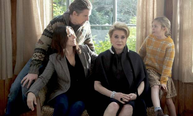 "From left, Ethan Hawke, Juliette Binoche, Catherine Deneuve and Clémentine Grenier star in ""The Truth."" [IFC Films]"