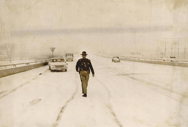 Jan. 19, 1966: A highway patrolman goes to the aid of a motorist stalled in the snowstorm on the Draper Expressway. [Photo by Tony Wood, The Oklahoman Archives]
