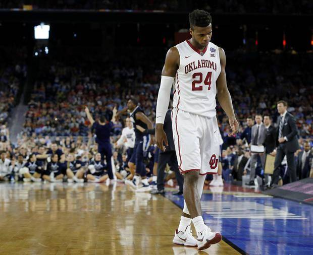 Oklahoma's Buddy Hield (24) walks off the court late in the second half of the national semifinal between the Oklahoma Sooners (OU) and the Villanova Wildcats in the Final Four of the NCAA Men's Basketball Championship at NRG Stadium in Houston, Saturday, April 2, 2016. Photo by Nate Billings, The Oklahoman
