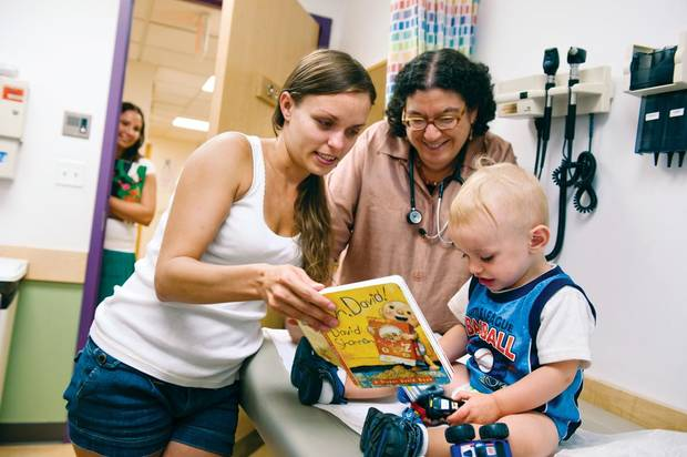 The early childhood development program Reach Out and Read encourages doctors to give an age appropriate book to children with each check-up during the first five years of their lives. (Photo provided by Reach Out and Read)