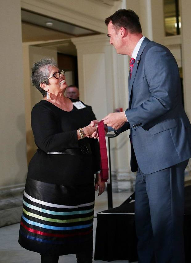 Juanita Pahdopony receives a Community Service Award from Gov. Kevin Stitt at the Governor's Arts Awards at the Capitol, Tuesday, April 16, 2019. [Photo by Doug Hoke/The Oklahoman]