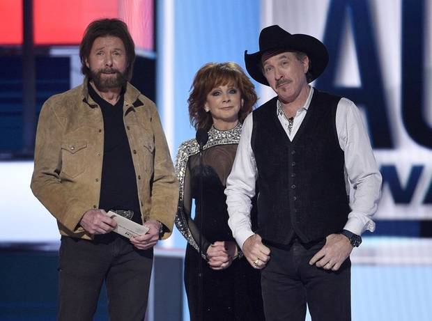 Ronnie Dunn, left, and Kix Brooks, right, of Brooks & Dunn, and host Reba McEntire present the award for entertainer of the year at the 54th annual Academy of Country Music Awards at the MGM Grand Garden Arena on Sunday, April 7, 2019, in Las Vegas. (Photo by Chris Pizzello/Invision/AP)