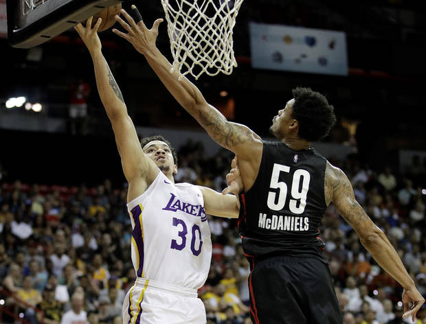 Los Angeles Lakers' Jeffrey Carroll (30) shoots around Portland Trail Blazers' K.J. McDaniels (59) during the second half of an NBA summer league basketball game Tuesday, July 17, 2018, in Las Vegas. (AP Photo/John Locher)