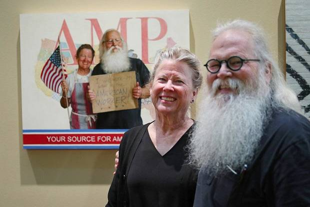 "Mary and John Seward stand in front of their portrait by Georgia-based Oklahoma native Mike Wimmer at the Oklahoma History Center, Thursday, March 21, 2019. An exhibit of Wimmer's portraits of Oklahomans titled ""Will Work For ..."" is on view through June 29 at the history Center. [Photo by Doug Hoke/The Oklahoman]"