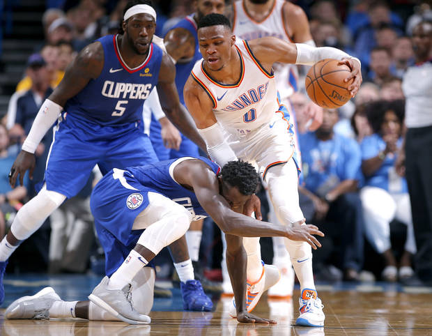 4afcce3c54a LA s Patrick Beverley (21) fouls Oklahoma City s Russell Westbrook (0)  during the