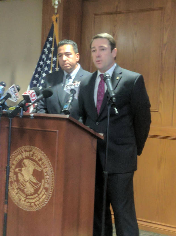 United States Attorney Mark A. Yancey speaks at a Monday news conference, while FBI Assistant Special Agent in Charge Raul Bujanda listens.