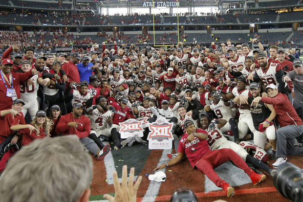 Holding Big 12 logos, the Sooners celebrate their 2019 conference football championship. (Photo by Bryan Terry)