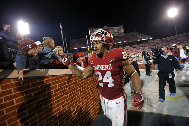 Oklahoma's Rodney Anderson (24) celebrates with fans after a college football game between the Oklahoma Sooners (OU) and the TCU Horned Frogs at Gaylord Family-Oklahoma Memorial Stadium in Norman on Nov. 11, 2017. [Photo by Bryan Terry, The Oklahoman]
