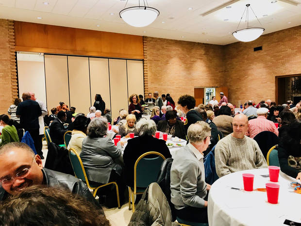 People sit at tables after enjoying a meal before the beginning of the 2018 NAACP/Jewish Cross Cultural Program on Jan. 14 at Temple B'nai Israel. [Photo by Carla Hinton, The Oklahoman]