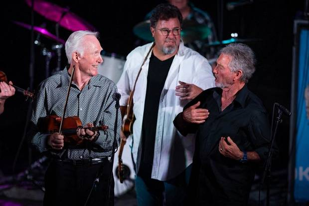 "From left, Byron Berline, Vince Gill and Larry Gatlin appear on stage Tuesday night at ""The Music Never Dies"" benefit concert on behalf of Berline at Guthrie's historic Scottish Rite Temple. [Photo provided by Tom Dunning]"