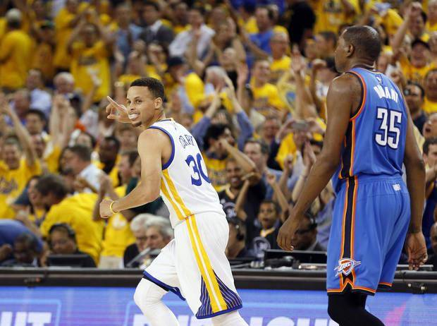 Golden State's Stephen Curry (30) celebrates after hitting a three-point shot as he runs back on defense in front of Oklahoma City's Kevin Durant (35) in the third quarter during Game 2 of the Western Conference finals in the NBA playoffs between the Oklahoma City Thunder and the Golden State Warriors at Oracle Arena in Oakland, Calif., Wednesday, May 18, 2016. Golden State won 118-91. Photo by Nate Billings, The Oklahoman