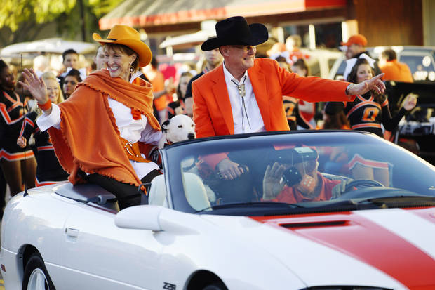 Oklahoma State president Burns Hargis and First Cowgirl Ann Hargis ride in the Sea of Orange Parade through downtown Stillwater in one of the final events of Oklahoma State's 2014 Homecoming. [Oklahoman Archive Photo]