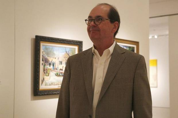 "Nick Berry, a member of the Oklahoma Society of Impressionists, talks about the artwork by 22 Oklahoma artists is displayed in the exhibit ""Between the Isms: The Oklahoma Society of Impressionists and Selected Oklahoma Expressionists"" at the Fred Jones Jr. Museum of Art in Norman Oklahoma on July 11, 2019. The exhibit is on view through Sept. 8. [Paxson Haws/The Oklahoman]"