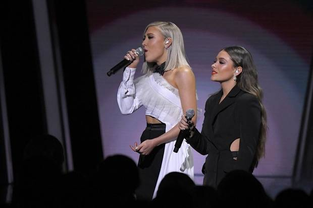 "Madison Marlow and Taylor Dye of Maddie & Tae perform ""Girl Crush""at the 53rd annual CMA Awards at Bridgestone Arena on Wednesday, Nov. 13, 2019, in Nashville, Tenn. [AP Photo/Mark J. Terrill]"