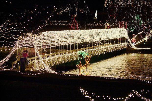 the dramatically lighted bridge is an annual showpiece of chickashas festival of light at shannon springs - Chickasha Christmas Lights