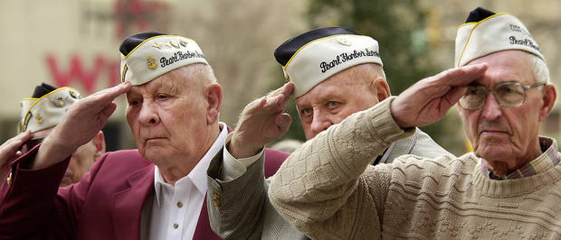 Bud Gilbert, far left, remembers Pearl Harbor on the 2001 anniversary.