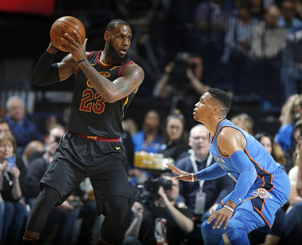 Russell Westbrook guards LeBron James during a February 2018 game. (Photo by Bryan Terry)