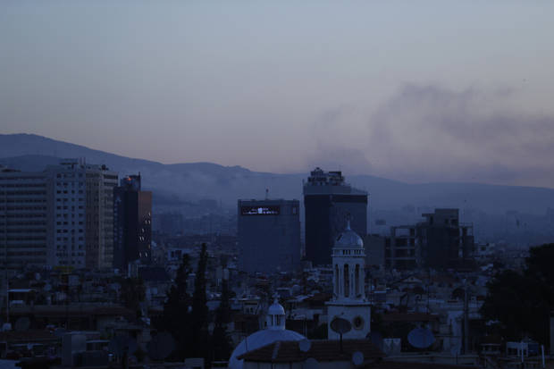 The Latest: Russia: Missiles aimed at Syrian air base downed