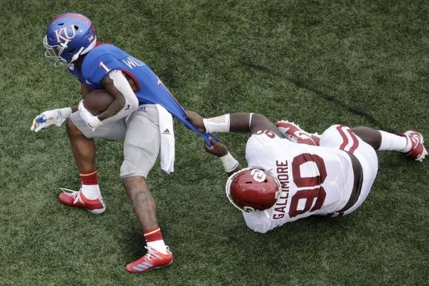 OU nose guard Neville Gallimore corrals Kansas tailback Pooka Williams on Saturday. (AP Photo).