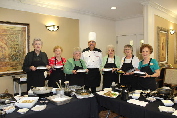 Participants of Concordia's Fire and Flavor cooking exhibition enjoy delicious food and time together. Left to right: Donna Seible, Bertie Poole, Fran Christenson, Chef Tony De Lara, Helen Lekawski, Joan Dozier, and Elena McVey. (Photo Provided)
