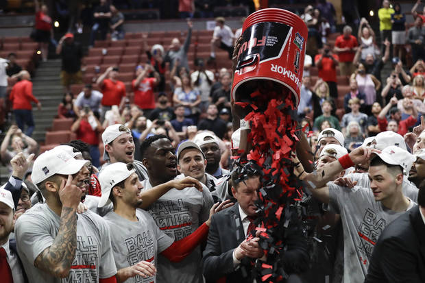Texas Tech players shower coach Chris Beard with confetti after beating Gonzaga  (AP Photo)