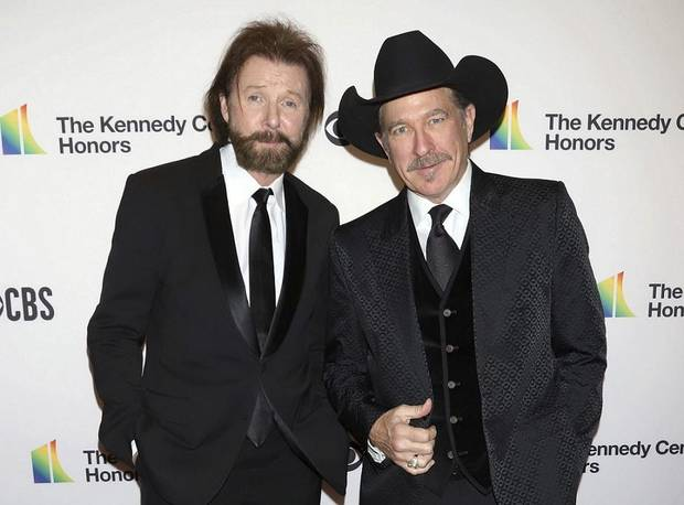 In this Dec. 2, 2018, file photo, Ronnie Dunn, left, and Kix Brooks attend the 41st Annual Kennedy Center Honors in Washington. Brooks & Dunn, comedic singer Ray Stevens and industry veteran Jerry Bradley will be inducted into the Country Music Hall of Fame later this year. The newest inductees were announced on Monday, March 18, 2019, in Nashville, Tennessee. [Photo by Greg Allen/Invision/AP, File]