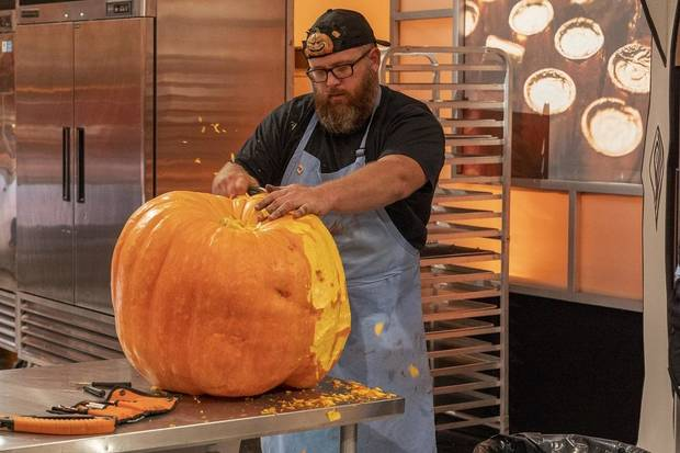"Team Mummies Rejects Pumpkin Carver Daniel Miller, who hails from Wilson, Oklahoma, works during Episode 2 of ""Halloween Wars"" Season 10. [Food Network photo]"