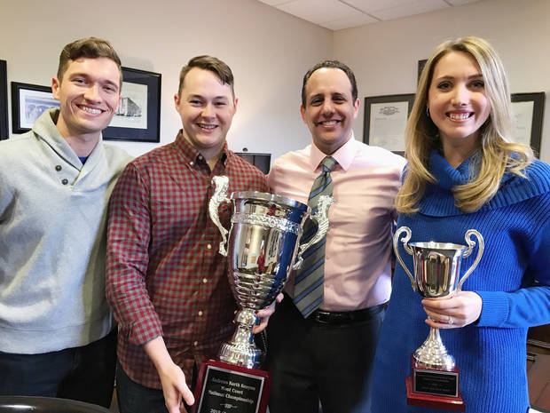 The team of third-year law students from the University of Oklahoma College of Law won first place in the 2018 Andrews Kurth Kenyon Moot Court National Championship. Ty Schoenhals, Connor Bourland and Kellie Laughlin with OU College of Law Dean Joseph Harroz Jr. [Photo Provided by OU]