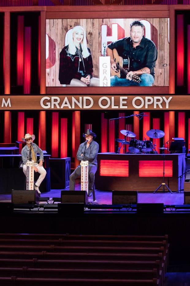 Dustin Lynch and Trace Adkins appear on the Grand Ole Orpy Saturday in Nashville, Tennessee, while Blake Shelton and Gwen Stefani appear remotely from Ole Red Tishomingo on the broadcast. [Chris Hollo/Grand Ole Opry]