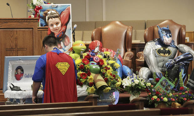 Dale Hall, dressed as Superman, stands before the casket during a superhero-themed funeral service for his brother, Jacob Hall at Oakdale Baptist Church on Wednesday, Oct. 5, 2016, in Townville, S.C.  A 14-year-old boy killed his own father, then drove to Townville Elementary and fired on two children and a teacher as recess began.  Jacob died Saturday. (Ken Ruinard/The Independent-Mail via AP, Pool)