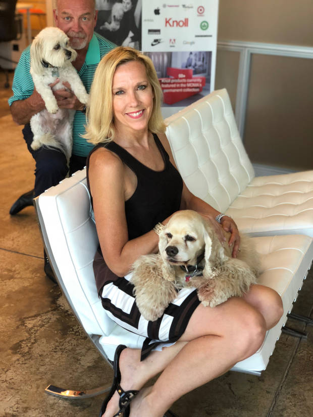 Commercial interior designer Alison Hafar, co-owner of Spaces Inc. in Edmond, has brought her cocker spaniel Bogey to work since he was a puppy. Her partner, Don Henke, is photo bombing, this shot with his rescue dog Buddy.