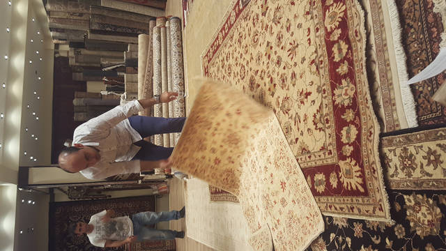 Hakan Zor, A Fifth Generation Turkish Rug Merchant, Displays Hand Woven Rugs