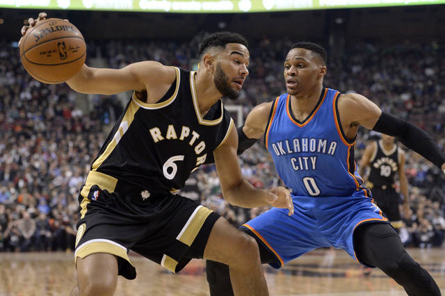 Oklahoma City's Russell Westbrook right defends Toronto's Cory Joseph during Thursday night's NBA game in Toronto. OKC whipped the Raptors 123-102