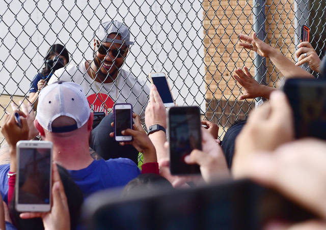 Fans line up for carmelo anthonys okc arrival news ok carmelo anthony greets fans as he arrives in oklahoma city sunday sept 24 2017 prinsesfo Images