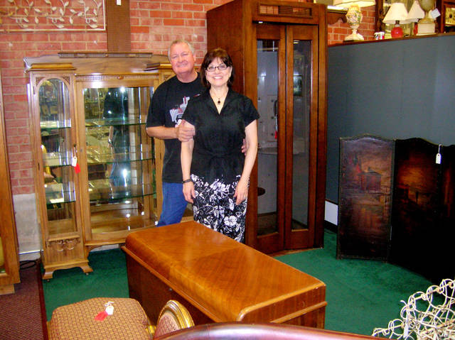 Owners Bill and Denny McConnell pose in front of some of the antique  merchandise on sale - After 25 Years In Business, Oklahoma City Antique Mall Proprietors