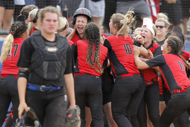 Westmoore's Jade Strickland celebrates with teammates after hitting the game-winning homer during the Class 6A slowpitch softball state championship game on Tuesday. The Jaguars beat Choctaw 23-22 at ASA Hall of Fame Stadium. [PHOTO BY BRYAN TERRY, THE OKLAHOMAN]